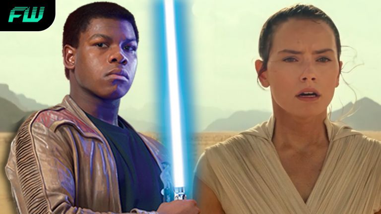 Finn with a lightsaber and Rey in Star Wars: The Rise of Skywalker