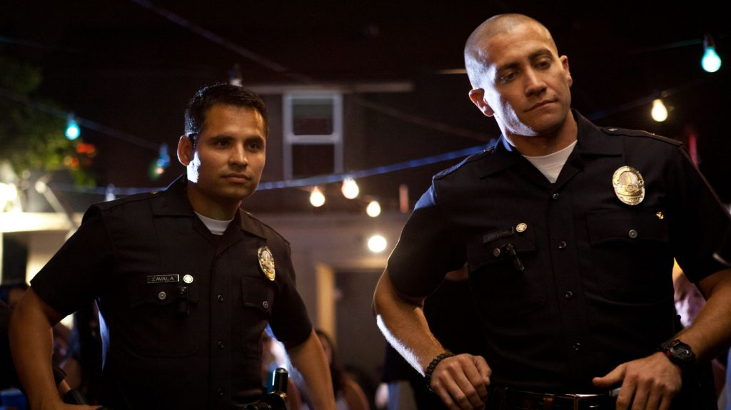 Jake Gyllenhaal and Michael Peña in End of Watch (2012)