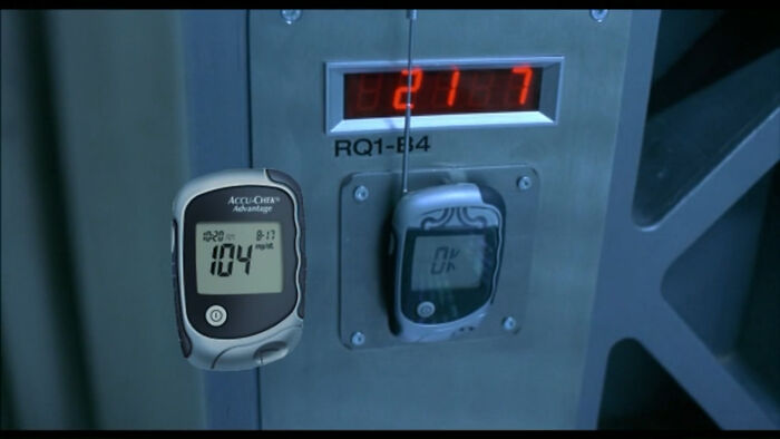 In Resident Evil(2002), the transmitter that cracks access codes is a glucose meter with an antenna.