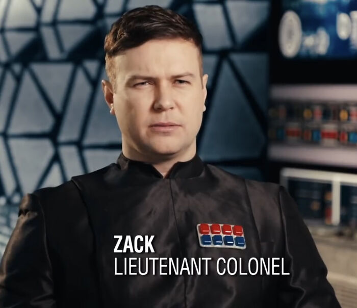 The first order officer wears a chest thing in The Kyle Ren Snl. It is a pack of gums.