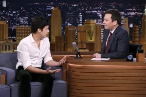 Cole with Jimmy Fallon